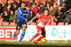 Swindon's Jacob Murphy and Orient's Dean Cox compete for the ball - Photo mandatory by-line: Mitchell Gunn/JMP - Tel: Mobile: 07966 386802 22/02/2014 - SPORT - FOOTBALL - Brisbane Road - Leyton - Leyton Orient V Swindon Town - League One