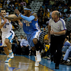 27 April 2009: Denver Nuggets forward Carmelo Anthony (15) passes on a fastbreak as New Orleans Hornets forward Peja Stojakovic (16) trails on defense during a 121-63 win by the Denver Nuggets over the New Orleans Hornets in game four of the NBA Western Conference Quarterfinals playoff game played at the New Orleans Arena in New Orleans, Louisiana.