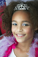 Young Girl in make-up tiara and boa Playing Dress Up