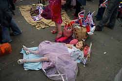 LOCATION, UK  29/04/2011. The Royal Wedding of HRH Prince William to Kate Middleton. LIttle girl in a princess outfit lying on the ground during the party in Trafalgar Square. Photo credit should read PAUL TREACY/LNP. Please see special instructions. © under license to London News Pictures