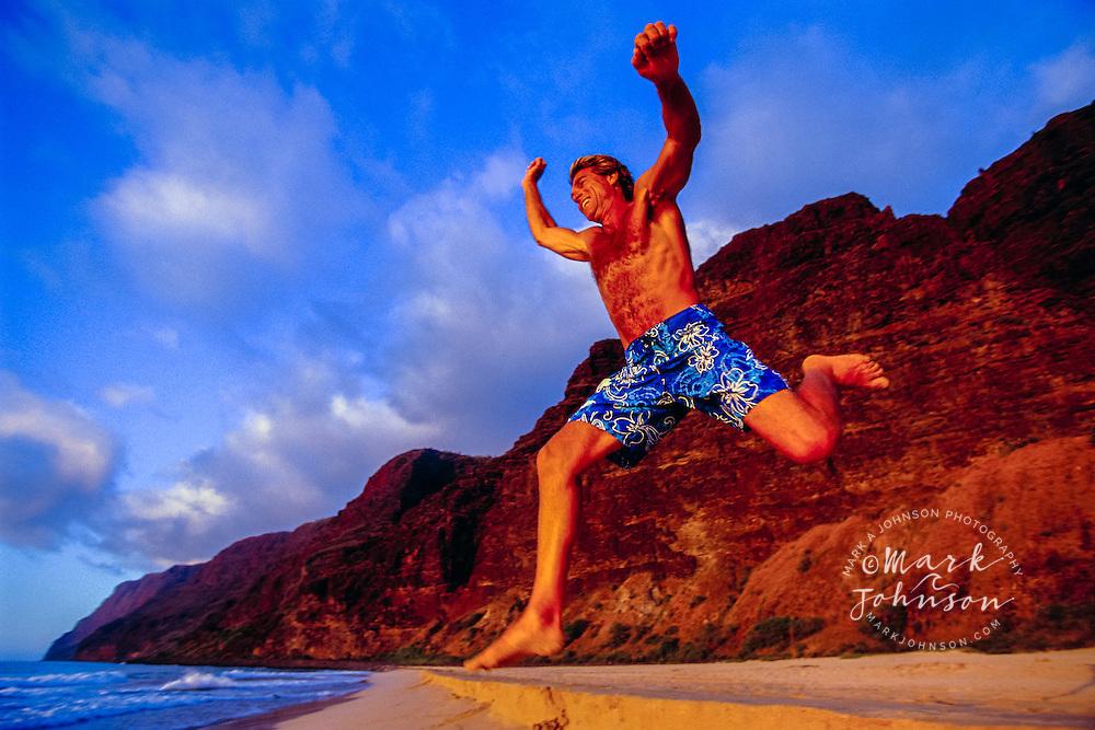 Happy Man Frolicking on Beach