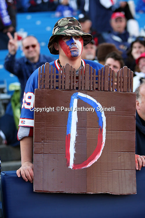 A Buffalo Bills fan holds up defense sign during the NFL football game against the Houston Texans, November 1, 2009 in Orchard Park, New York. The Texans won the game 31-10. (©Paul Anthony Spinelli)