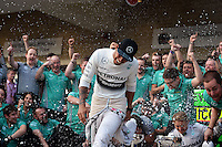 Race winner Nico Rosberg (GER) Mercedes AMG F1 celebrates with the team.<br /> United States Grand Prix, Sunday 2nd November 2014. Circuit of the Americas, Austin, Texas, USA.