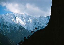 Pakistan, Northwest Frontier Province, 2004. The forbidding foothills of the Hindu Kush lock in the three main Kalash villages for periods up to five months a year.