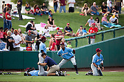 Members of the Northwest Arkansas Naturals stretch prior to a game against the Springfield Cardinals at Hammons Field on August 23, 2013 in Springfield, Missouri. (David Welker)