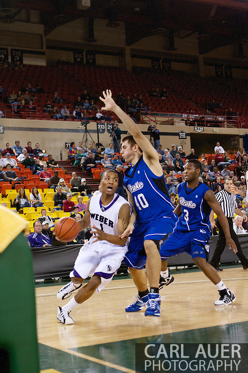 November 27th, 2010:  Anchorage, Alaska - Weber State junior guard Damian Lillard (1) drives in the Wildcats 82-81 victory over the Drake Bulldogs in the third place game of the Great Alaska Shootout.