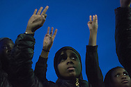 11/18/15 – Medford/Somerville, MA – Tufts students rally for racial justice with Harvard students in Porter Square on Nov. 18, 2015. (Sofie Hecht / The Tufts Daily)