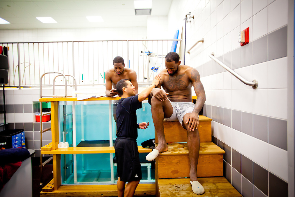 MIAMI, FL -- January 29, 2012 -- Miami guard Dwyane Wade, left, and forward LeBron James get in a chiller tank of 43 degree water in the locker room as assistant trainer Mike Mancias, center, tends to his shoulder after the Heat's 97-93 win over the Chicago Bulls at American Airlines Arena in Miami, Fla., on Sunday, January 29, 2012.  (Chip Litherland for ESPN the Magazine)