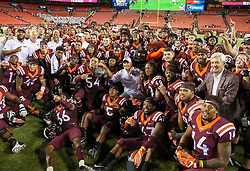 Sep 3, 2017; Landover, MD, USA; The Virginia Tech Hokies pose for a team photo after beating the West Virginia Mountaineers at FedEx Field. Mandatory Credit: Ben Queen-USA TODAY Sports