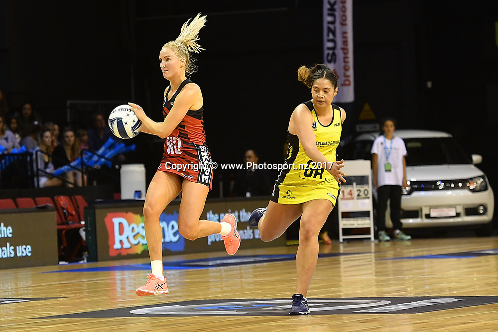 Tactix's Hayley Saunders (L) looks to pass with Pulse's Tiana Metuarau during the ANZ Premiership netball match between the Wellington Pulse vs Mainland Tactix at TSB Arena in Wellington on Sunday the 9th of April 2017. Copyright Photo by Marty Melville / www.Photosport.nz