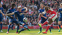 Football - 2016 / 2017 Premier League - Arsenal vs. Manchester United<br /> <br /> Phil Jones of Manchester United blocks the goalbound shot of Danny Welbeck of Arsenal at The Emirates.<br /> <br /> COLORSPORT/DANIEL BEARHAM
