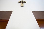 A crucifix hangs on the wall in the waiting room of the NDA health center in Dimbokro, Cote d'Ivoire on Friday June 19, 2009.