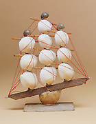 Still life of a model boat made of seashells