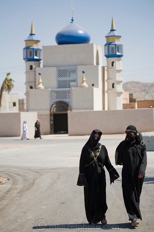 Women walk on the street in a fabricated Iraqi village of Medina Wasl, at Camp Irwin,  California.