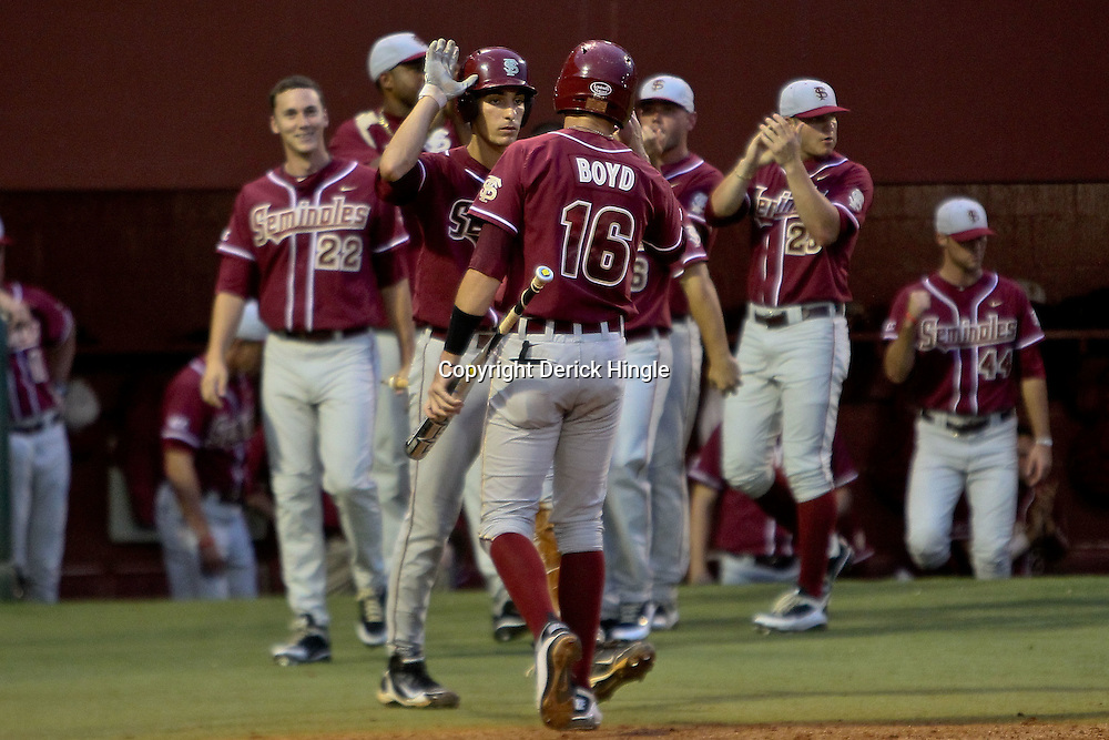 June 04, 2011; Tallahassee, FL, USA; Florida State Seminoles first baseman Jayce Boyd (16) celebrates with teammates after scoring during the third inning of the Tallahassee regional of the 2011 NCAA baseball tournament against the Alabama Crimson Tide at Dick Howser Stadium. Mandatory Credit: Derick E. Hingle