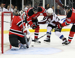 Oct 15; Newark, NJ, USA; New Jersey Devils goalie Martin Brodeur (30) makes a pad save on Colorado Avalanche center Paul Stastny (26) while New Jersey Devils defenseman Henrik Tallinder (7) and New Jersey Devils left wing Patrik Elias (26) defend during the first period at the Prudential Center.