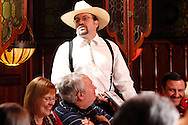 "Jerry Francis as Charles Stun (standing) during Mayhem & Mystery's production of ""Deadly Dancing"" at the Spaghetti Warehouse in downtown Dayton, Monday, January 7, 2013."
