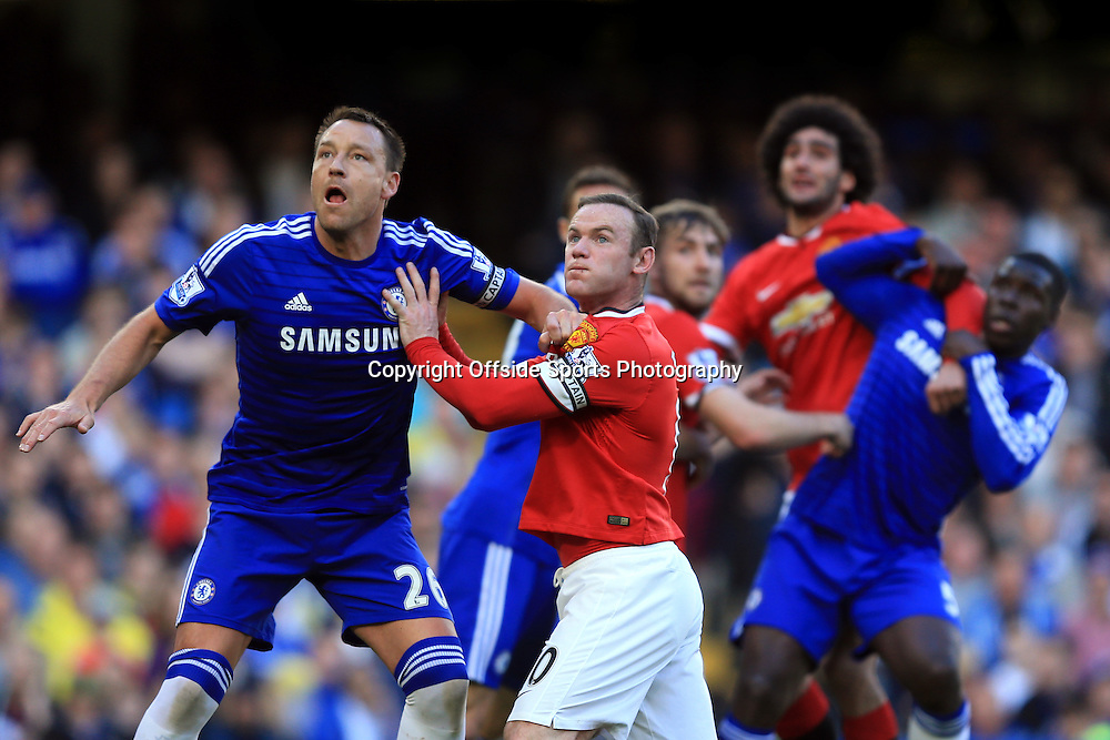 18 April 2015 - Barclays Premier League - Chelsea v Manchester United - John Terry of Chelsea tangles with Wayne Rooney of Manchester United - Photo: Marc Atkins / Offside.