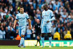 Sergio Aguero and Yaya Toure of Manchester City look dejected after Mame Biram Diouf of Stoke scores a goal to give his side a 0-1 lead - Photo mandatory by-line: Rogan Thomson/JMP - 07966 386802 - 30/08/2014 - SPORT - FOOTBALL - Manchester, England - Etihad Stadium - Manchester City v Stoke City - Barclays Premier League.