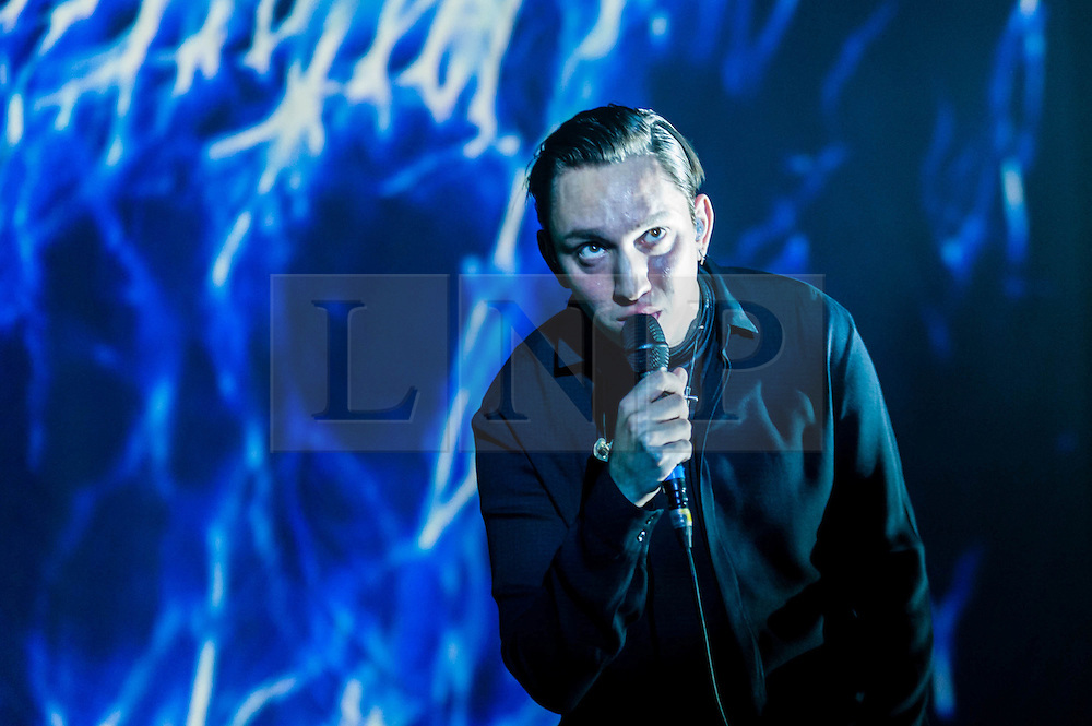 """© Licensed to London News Pictures. 16/12/2012. London, UK.   Oliver Sim of The XX performing live at O2 Academy Brixton. The xx are an English indie band, formed in London in 2008.  In 2010, the band won the Mercury Music Prize for their debut album, xx.  The band is composed of Romy Madley Croft (vocals, guitar),  Oliver Sim (vocalis, bass) , and .Jamie """"Jamie XX"""" Smith (percussion, producer). Photo credit : Richard Isaac/LNP"""