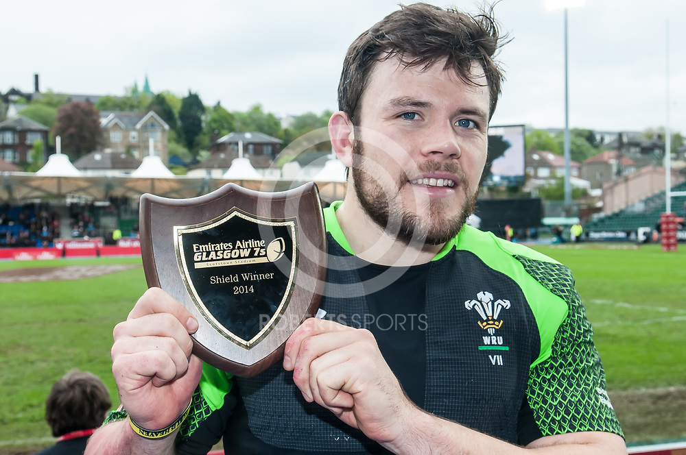 Wales' captain Adam Thomas with the Shield trophy after victory against Japan. Action from the IRB Emirates Airline Glasgow 7s at Scotstoun in Glasgow. 4 May 2014. (c) Paul J Roberts / Sportpix.org.uk