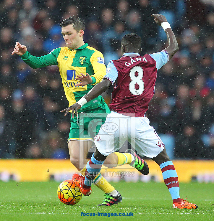 Jonny Howson of Norwich and Idrissa Gana of Aston Villa in action during the Barclays Premier League match at Villa Park, Birmingham<br /> Picture by Paul Chesterton/Focus Images Ltd +44 7904 640267<br /> 06/02/2016