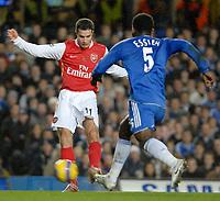 Photo: Ed Godden.<br /> Chelsea v Arsenal. The Barclays Premiership. 10/12/2006.<br /> Arsenal's Robin Van Persie (L) gets the ball past Michael Essien.