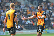 Hull City midfielder Jake Livermore (14) reacts at the final whistle  during the Sky Bet Championship match between Hull City and Rotherham United at the KC Stadium, Kingston upon Hull, England on 7 May 2016. Photo by Ian Lyall.