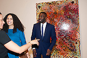 CHRIS OFILI AND HIS WIFE, Chris Ofili dinner to celebrate the opening of his exhibition. Tate. London. 25 January 2010
