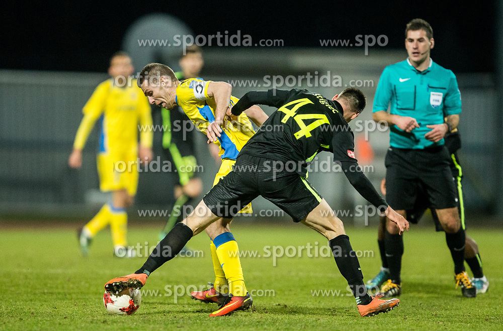 Luka Zinko of NK Domzale vs Dino Stiglec of Olimpija during football match between NK Domzale and NK Olimpija Ljubljana in 24th Round of Prva liga Telekom Slovenije 2016/17, on March 12, 2017 in Sports park, Domzale, Slovenia. Photo by Vid Ponikvar / Sportida