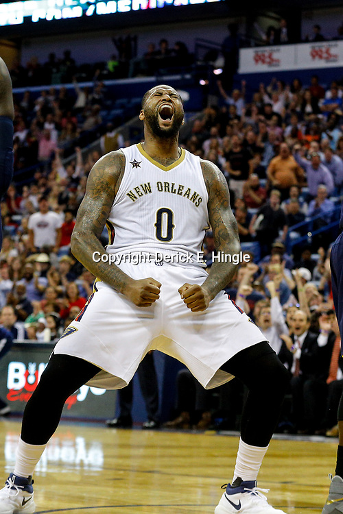 Mar 21, 2017; New Orleans, LA, USA; New Orleans Pelicans forward DeMarcus Cousins (0) celebrates after scoring and drawing foul during the fourth quarter of a game against the Memphis Grizzlies at the Smoothie King Center. The Pelicans defeated the Grizzlies 95-82. Mandatory Credit: Derick E. Hingle-USA TODAY Sports