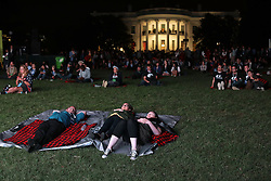 October 3, 2016 - Washington, DC, United States of America - Attendees watch a movie while resting during the South by South Lawn festival on the South Lawn of the White House October 3, 2016 in Washington, DC. The event is inspired by the South by Southwest festival and includes arts, film, entertainment and technology. (Credit Image: © Chuck Kennedy/Planet Pix via ZUMA Wire)
