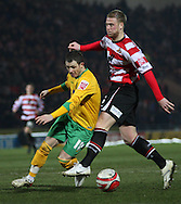 Doncaster - Friday January 30th 2009:Jamie Cureton of Norwich City & Matthew Mills of Doncaster Rovers in action during the Coca Cola Championship Match at The Keepmoat Stadium Doncaster. (Pic by Steven Price/Focus Images)