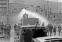 British soldiers use a water canon against rioters on the Lower Falls Road area of Belfast. The rioting broke out following a People's Democracy march which was prevented by soldiers and police from entering the city centre in Belfast, N Ireland. The march was in support of PD leaders Michael Farrell and Tony Canavan who were on hunger strike seeking political status in Belfast's Crumlin Road Jail.  29 July 1973, 197307290522h<br />