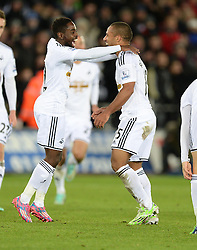 Swansea City's Wayne Routledge celebrates with Swansea City's Nathan Dyer - Photo mandatory by-line: Alex James/JMP - Mobile: 07966 386802 - 02/12/2014 - SPORT - Football - Swansea - Liberty Stadium - Swansea City v QPR - Barclays Premier League