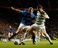 Photo: Jed Wee.<br /> Celtic v Glasgow Rangers. Scottish CIS Insurance Cup. <br /> 09/11/2005.<br /> <br /> Rangers' Dado Prso (L) tries to hold off Celtic's Stephen McManus.