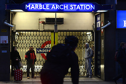 Tube Strike. Would-be passengers wait  outside the closed Marble Arch tube station. Marbe Arch, London, United Kingdom. Wednesday, 5th February 2014. Picture by Peter Kollanyi / i-Images
