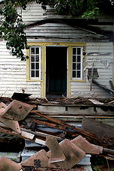 24 August 2012. New Orleans, Louisiana,  USA. .Blighted housing in the Lower 9th ward. In a tale of two cities, Hurricane Katrina devastated the area smashing almost all residences following the collapse of the levees. Whereas Brad Pitt's 'Make it Right Foundation' has provided a stimulus for rebuilding a limited area of the Lower 9th ward, much remains to be done as the 7th year anniversary of Hurricane Katrina approaches on August 29th..Photo; Charlie Varley.