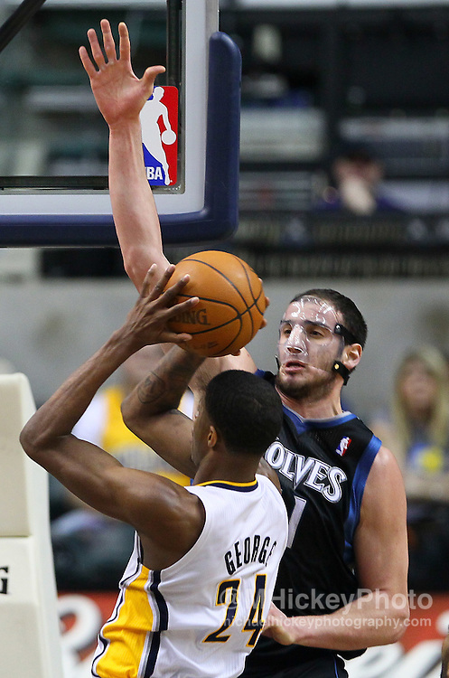 Feb. 11, 2011; Indianapolis, IN, USA; Minnesota Timberwolves center Kosta Koufos (41) defends as Indiana Pacers forward Paul George (24) goes up for a shot at Conseco Fieldhouse. Mandatory credit: Michael Hickey-US PRESSWIRE