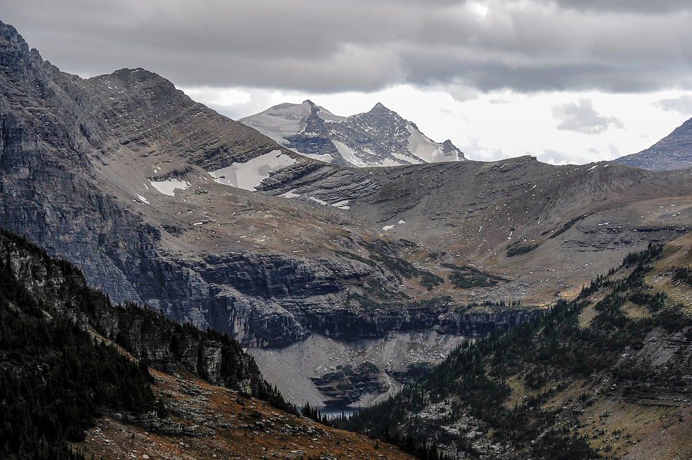Sperry Glacier as viewed from Mount Clements is on the left side of the distant peak known as Gunsight Mountain, Glacier National Park, Montana, Tuesday, October 7, 2014. Sperry Glacier, one of the largest glaciers remaining in the park, is the glacier most studied by the USGS. Hidden Lake is visible in the lower center frame. Edwards Mountain is to the right of Gunsight.