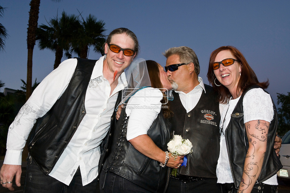 5th June 2010. Las Vegas, Nevada. Known around the world as one of the most Famous places to be married, The Little White Wedding Chapel in Las Vegas has wed stars from Britney Spears to Judy Garland. Pictured is Julie Boswell, 49 and Larry Willfret, 51, from Chicago. They had driven all the 1748 miles on their bikes with their friends Heather, 45, and Greg Malenshek, 39 PHOTO © JOHN CHAPPLE / www.chapple.biz.john@chapple.biz  (001) 310 570 9100.