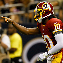 September 9, 2012; New Orleans, LA, USA; Washington Redskins quarterback Robert Griffin III (10) celebrates a touchdown against the New Orleans Saints during the first quarter of a game at the Mercedes-Benz Superdome. Mandatory Credit: Derick E. Hingle-US PRESSWIRE