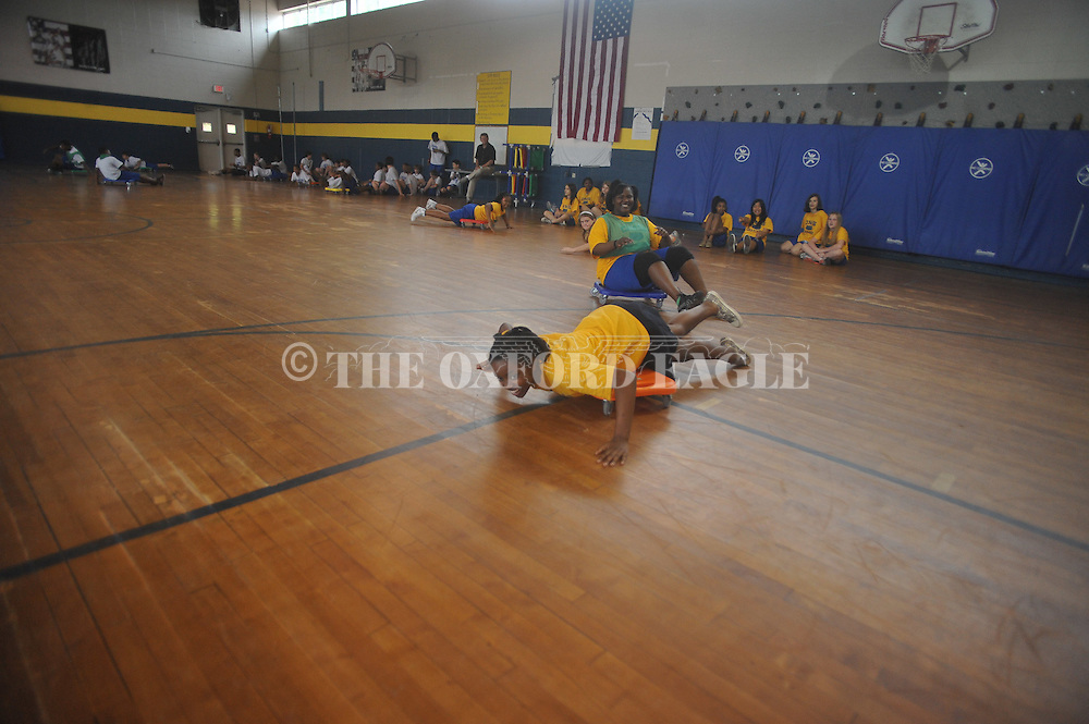 Students play a game during a class in the gym at Oxford Middle School in Oxford, Miss. on Tuesday, April 26, 2011. On Monday night, the Oxford School District approved a $3 million project to demolish and rebuild the school gym. Eight additional classrooms will be constructed on top of the new gym to expand the school.