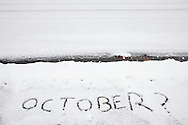 "Middletown, New York  - ""October?"" is written on a snow-covered sidewalk during a snowstorm on Oct. 29, 2011."