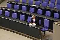 01 JUL 2004, BERLIN/GERMANY:<br /> Joschka Fischer, B90/Gruene, Bundesaussenminister, sitzt alleine in der regierungsbank und schreibt in seine Akten, nach der gemeinsamen Sitzung von Bundestag und Bundesrat anl. der Vereidigung des Bundespraesidenten, Plenum, Deutscher Bundestag<br /> IMAGE: 20040701-01-059<br /> KEYWORDS: schreiben, Unterlagen, papers