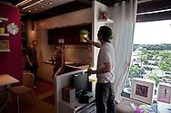 """Roma 9 Giugno 2010.Studenti e precari del gruppo attivo su Facebook """"Fai la valigia"""", hanno occupato simbolicamente gli appartamenti modello presenti dentro la sede di Ikea di Anagnina per per il diritto alla casa e il welfare studentesco..Rome June 9, 2010.Students and insecure group active on Facebook """"Make suitcase, symbolically occupied apartments model, present inside the headquarters of Ikea Anagnina for the right to housing and welfare students."""