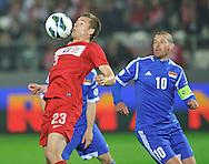 Poland, Krakow - June 04 .<br />Poland vs Lichtenstein International Friendly match at Cracovia Stadium on June 2, 2013 in Krakow.<br />Artur Sobiech of Poland and Mario Frick of Lichtenstein.<br />Photo by: Piotr Hawalej