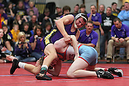 Alburnett's Dylan Winfield (top) tries to turn East Buchanan's Mitch Platte in a 160-pound bout during the Class 1A sectional wrestling tournament at East Buchanan High School in Wintrhop on Saturday, February 4, 2012. Winfield won with a fall in 1:18. (Stephen Mally/Freelance)