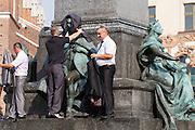 Poland, Krakow. Rynek Glówny (Market Square). Adam Mickiewicz monument.