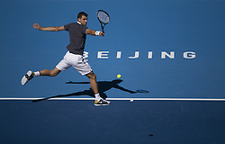 BEIJING, Oct. 3, 2018  Grigor Dimitrov of Bulgaria hits a return during the men's singles second round match against Dusan Lajovic of Serbia at China Open tennis tournament in Beijing, China, Oct. 3, 2018. Grigor Dimitrov lost 1-2. (Credit Image: © Song Yanhua/Xinhua via ZUMA Wire)